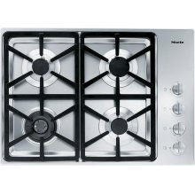 KM 3464 LP Gas cooktop with a dual wok burner for particularly wide ranging burner capacity.