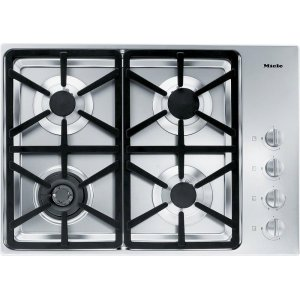 MieleKM 3464 LP Gas cooktop with a dual wok burner for particularly wide ranging burner capacity.