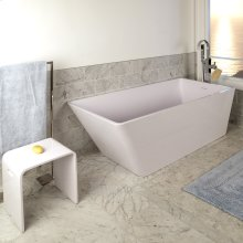Free-standing soaking bathtub made of white solid surface with an overflow and polished chrome drain, net weight 440lbs, water capacity 112 gal.