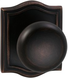 Interior Traditional Knob Latchset with Arched Rose in (TB Tuscan Bronze, Lacquered)