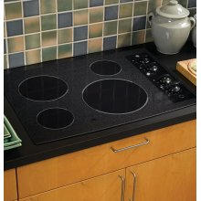 "FLOOR MODEL (KS #7) - GE® 30"" Built-In CleanDesign Electric Cooktop - CALL (508) 339-1002 FOR MORE INFORMATION."