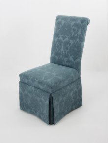 Roll back skirted chair