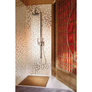 Thermostatic shower with exposed column and hand shower.