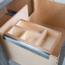Add-on hanging organizer made of baltic birch in natural finish and brushed stainless steel bracket.