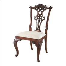 CARVED AGED REGENCY FINISHED M AHOGANY CHIPPENDALE SIDE CHAIR , WOVEN CARAMEL FABRIC