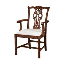 CARVED AGED REGENCY FINISHED M AHOGANY CHIPPENDALE ARMCHAIR, WOVEN CARAMEL FABRIC