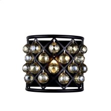 Hand polished clear crystal spheres hang like gems from a forged iron grid. The circle meets the square in an explosion of reflection. Also comes with multi-faceted crystal balls in golden teak or silver shadow.