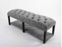 Button tufted bench with upholstered shelf.