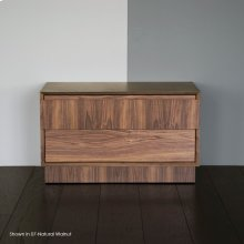Free-standing storage cabinet on casters with wood pull on single large drawer and one small internal drawer.