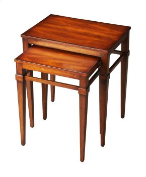 Elevated stretchers on both tables create a banding aesthetic that unites the versatile pair of accent tables. Crafted from rubber wood and cherry veneers in the Antique Cherry finish.
