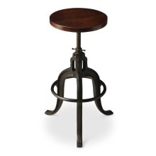 This early industrial-look barstool revolves and adjusts to the desired height, making it an ideal seat for all sizes and tables. With a dark brown finished recycled wood seat, its three-legged design ensures stability and iron circle base serves as a con