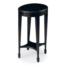 This elegant Accent Table, handcrafted from selected hardwood solids, wood products and choice veneers, is perfectly proportioned to sit beside a comfortable chair or serve as a bedside table. It features a crackled Plum Black finish with red undertones.