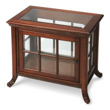 Selected solid woods and choice oak veneers. Beveled glass top. Three glass sides and door with antique brass finished hardware. Adjustable glass shelf.