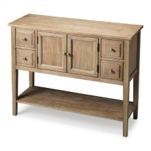 This Shaker-inspired sideboard is a wonderful addition to a kitchen, dining room or even an entryway. It boasts plenty of storage with four drawers, a storage cabinet behind its doors and lower display shelf. Expertly crafted from solid mindy hardwood wit