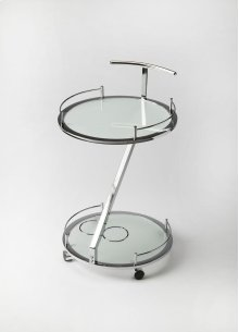 This ultra-modern Gigi serving cart is made out of Nickel chrome. The frosted tempered glass shelves are a great place to display your food and beverages. The tray table is supported by a wine rack for your best vintages.