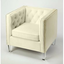 This arm chair is styled with high tuxedo arms, accent silver nailheads, putton tuft soft polyester velvet upholstery, and tapered clear acrylic legs. This living room chair has been built with a solid-hardwood frame that is corner blocked and glued for e