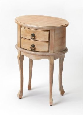 This charming oval side table combines elegant design details with convenient storage. Featuring a distressed Driftwood finish and oak veneer top, it is hand crafted from select hardwood solids and wood products, and includes two drawers with antique bras