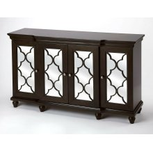 Versatility that is making a style statement within this mirrored sideboard. The beautifully cut fretwork adorned over the mirror paneled doors simply capture the eye. The multi dimensional design of the surface trim offers a taste of distinction and app