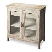 The Ronan sideboard has a classic rustic look. The glass doors prominently feature whatever you place inside on the shelves and the two drawers add extra storage. The light finish on this piece draws attention to its simple beauty.