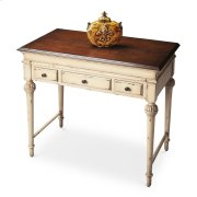 Elegantly tapered and Sheraton-inspired legs establish the antique motif for this lightly distressed desk that is small enough to fit into nooks and crannies but large enough to get the job done. It features a top that lifts open into a large work space, Product Image