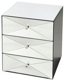This stunning mirrored accent chest is sure to elicit attention. Crafted from select wood solids and wood products, it features clear mirrored glass and three spacious drawers with a harlequin geometric pattern and clear acrylic pulls.