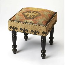 Imbued with Southwestern and Bohemian design influences, this unique stool is a comfy place to rest your feet and store your stuff. Made from acacia wood solids and wood products, it is upholstered in a colorful jute fabric with black nail head trim to ma