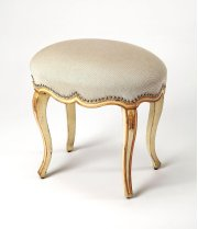 Fit for royalty, there's not a straight line found on this elegant oval hand painted vanity stool. Expertly crafted from rubberwood solids, it boasts a rich cream hand painted base with gold hand painted trim and carved flourishes on its legs. Silver fini Product Image