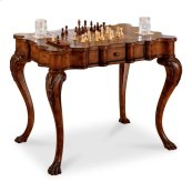 Selected solids and choice veneers. Hand carved details. Reversible game board with chess on one side and backgammon on reverse. Two drawers with antique brass finished hardware. Includes all game pieces for chess, checkers, backgammon and cribbage.