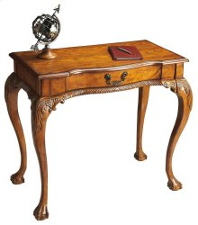 Selected solid woods, wood products and choice oak veneers. Oak veneer top. Finished on all sides. Hand carved details. Drawer with antique brass finished hardware.