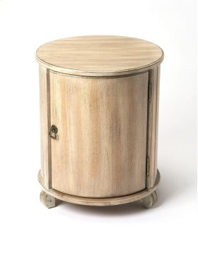 The bauty of this classic drum table is in its simplicity. Handcrafted from select hardwood solids , wood products, choice Oak veneers for a delightfully brush distressed Driftwood finish, with antiqued brass finished hardware, it boasts ample sotrage wit