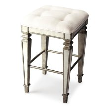 This glamorous bar stool delivers vintage style to your home with antique mirror inlays along its legs and apron and a tufted cotton upholstered ivory cushion. It is hand crafted from select hardwood solids and wood products featuring a pewter finish for
