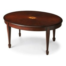 Timeless in its allure, this elegant cocktail table features a delicate maple veneer linen-fold inlay as its focal point and exquisitely tapered legs. Meticulously crafted from poplar hardwood solids and wood products, it boasts a matched cherry veneer to
