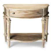 This elegant console table has a relaxed traditional aesthetic. Crafted from select hardwood solids and wood products, Its moderately distressed Driftwood finish enhances the oak veneer surfaces and hand carved details. It includes a handy storage drawer Product Image