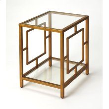 This classic rectangular end table will add sophisticatication to any modern living space. Its all metal frame boasts an inviting antique gold finish with a tempered glass top and lower display shelf. Pair it with matching coffee table style 9215397 to co