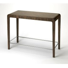 Enhance your kitchen, bar or work space with this modern bentwood pub table. Its ebony veneer surface and waterfall edge sides are attractively complemented by a chrome plated steel tube stretcher.