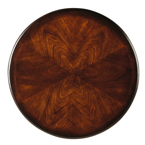 Geometric shapes combine innovatively to create this enchanting accent table with six-way matched cherry veneer round top. Three, straight, carved legs join the interesting top with complementing triangular shelf below. Handcrafted from select hardwood so