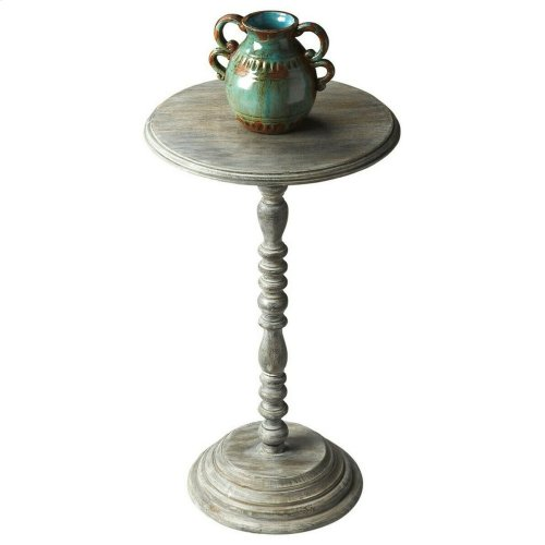 Designed to snuggle into favorite nooks and crannies, this small table features an elaborately turned pedestal and base, and beautifully beveled edge on the tabletop. The transparent finish celebrates the exotic mango wood's elegant graining.