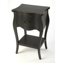 Crafted from mahogany veneer and wood products in a stylish black finish, this nightstand is perfect for stowing bedside essentials. This lovely nightstand showcases a single drawer with iron hardware, a scalloped apron and lower display shelf.
