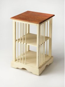 """Is it a bookcase or is it a table"""" It is both! Timeless in its inspiration, this bookcase table is crafted from mahogany wood solids and features a two-tone finish of cream below with a crackled mahogany top resembling crusty bread."""