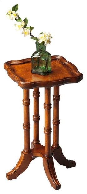 This distinctive table crafted from solid hardwoods features four delicately turned posts supporting a square tabletop with elegant patterns of olive ash burl veneers inside a subtly scalloped edge.