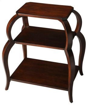 This distinctive tiered side table is ideal paired beside a chair or sofa. Crafted from select hardwood solids, wood products and resin components, it features shapely rounded legs supporting its top and two lower shelves - each made with cherry veneer. B