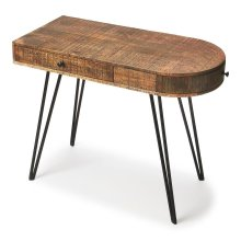 This sleek writing desk will stylishly enhance your space. Featuring a modern loft aesthetic, it is hand crafted from mango wood solids, iron.