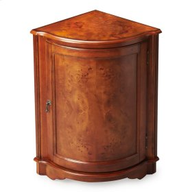 Perfect for dressing up a neglected corner, this cabinet features olive ash burl veneers along its top and door panel. The door, adorned with a pull in an antique brass finish, opens to reveal a shelf within its always-welcome storage space. Crafted from