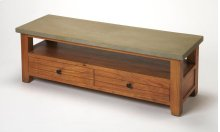 This hip entertainment console combines vintage Mission styling with urban edge. Its solid acacia wood base has a light caramel finish - on the front, sides and back - supporting a gray sealed concrete top. Besides supporting a widescreen television, it f