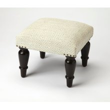 Get a leg up, or better yet two, on a comfortable and plump upholstered ottoman with substantial, turned wood legs in a casual finish
