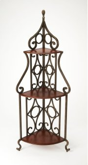 This one-of-a-kind baker's rack has a charm all its own. Ruggedly constructed, its forged decorative pewter metal frame and fruitwood finished wood shelves give it a distinctive appearance. The corner design of this baker's rack also gives it versatility Product Image