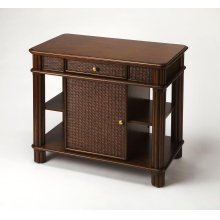 Add storage and working space to your kitchen with this island-inspired kitchen island. Crafted from mahogany wood solids and wood products, it boasts an inviting cocoa finish - on all sides - with woven rattan inlays on its door panels, drawer fronts and