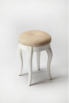 This splendid vanity stool adds formal elegance to any powder or dressing room. Handcrafted from hardwood solids and veneers, it features curvy tapered legs, ballerina feet, Cottage White finish and a comfortable seat upholstered in cotton hobnail fabric.