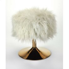 Tastefully textured and fashion forward, this faux fur stool is sure to make a statement in any space. Founded atop a pestal, metal base finished in gold, this piece features a round seat that's covered in faux fur upholstery for a hint of plush glamour.