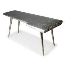 This Desk is riveting, soaring with the flair of an airplane wing and guaranteed to help a room take flight. Crafted from polished aluminum and rivets, this shimmering desk sits atop four matching legs that taper down for a very smooth landing indeed.